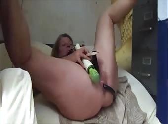 Grandma Masturbating With Two Dildo And Vibrator